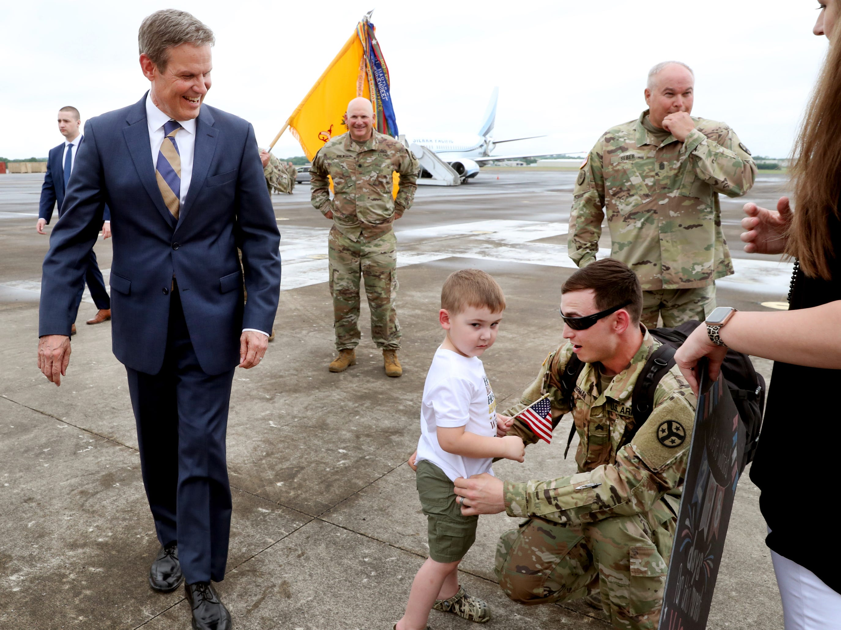 Tennessee Governor Bill Lee watches as Sgt. Cody Chipman, with the 278th ACR is reunited with his son Camden Chipman, 3 as he returns to the Volunteer Training Site in Smyrna, from a 9 month overseas deployment on Thursday, May 9, 2019.