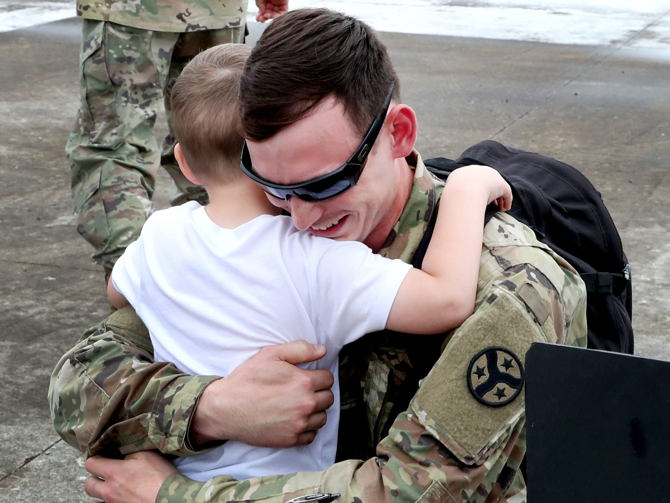 Sgt. Cody Chipman, with the 278th ACR hugs his son Camden Chipman, 3 as he returns to the Volunteer Training Site in Smyrna, after a 9 month overseas deployment on Thursday, May 9, 2019.