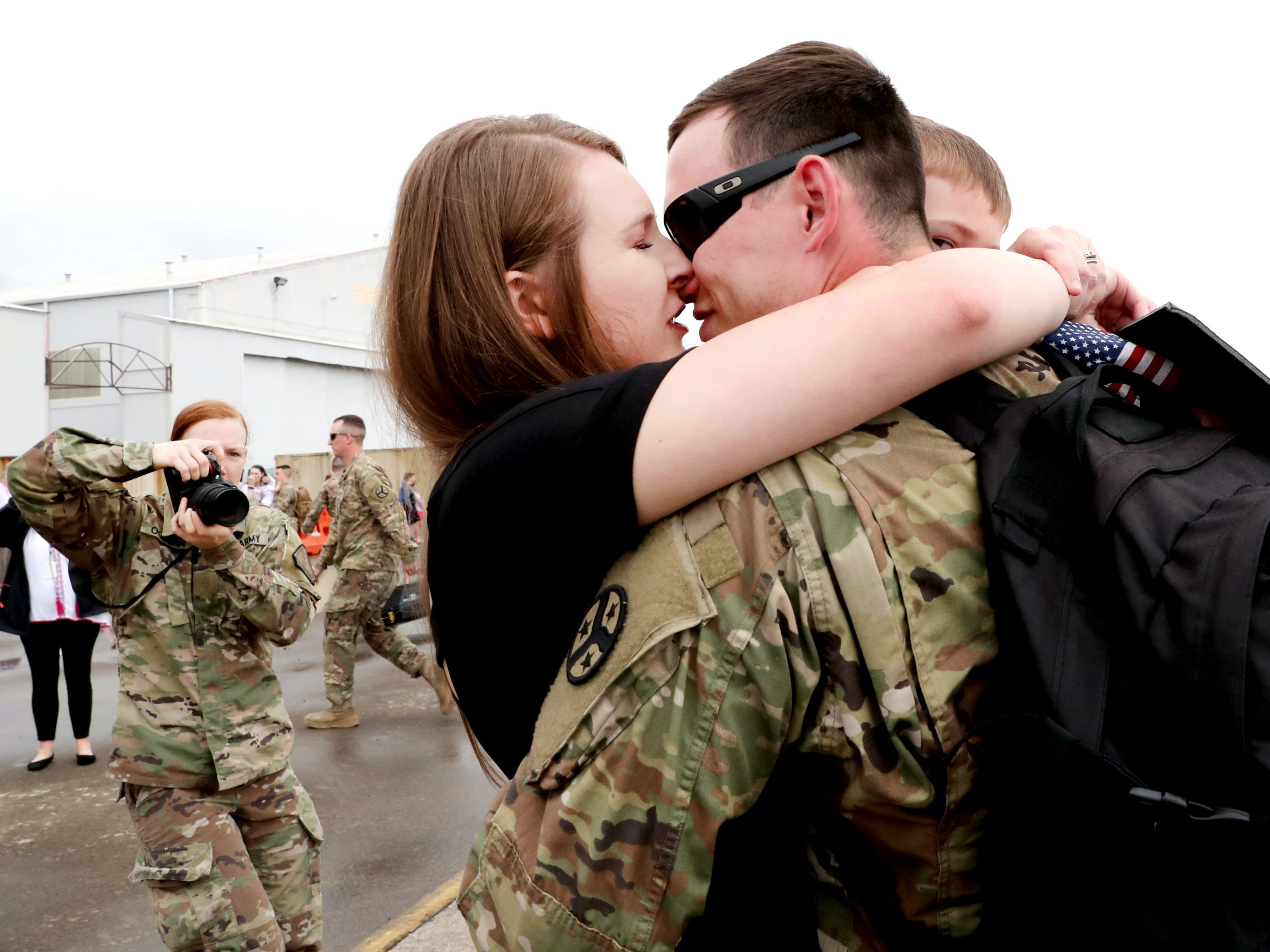 Kristin Chipman kisses her husband Sgt. Cody Chipman, with the 278th ACR after he gets off a plane at the Volunteer Training Site in Smyrna, from a 9 month overseas deployment on Thursday, May 9, 2019.