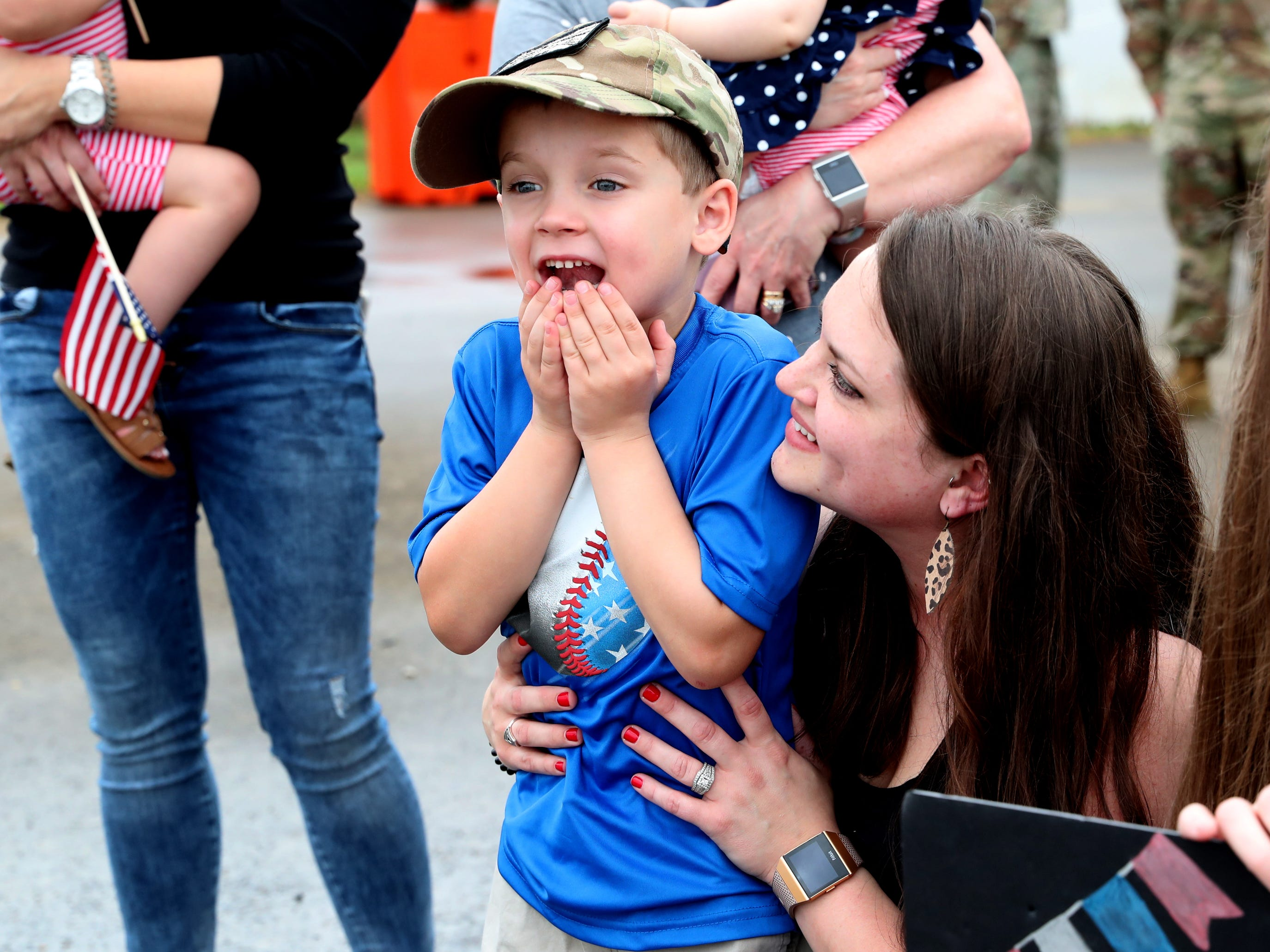 Whitt Baker, 5, wait reacts as his father Sgt. Jake Baker gets ready to leave the plane to come home as his mom Molly Baker watches him and also waits for her husband's return with the 278th ACR, from a 9 month overseas deployment on Thursday, May 9, 2019. They returned to the Volunteer Training Site in Smyrna.