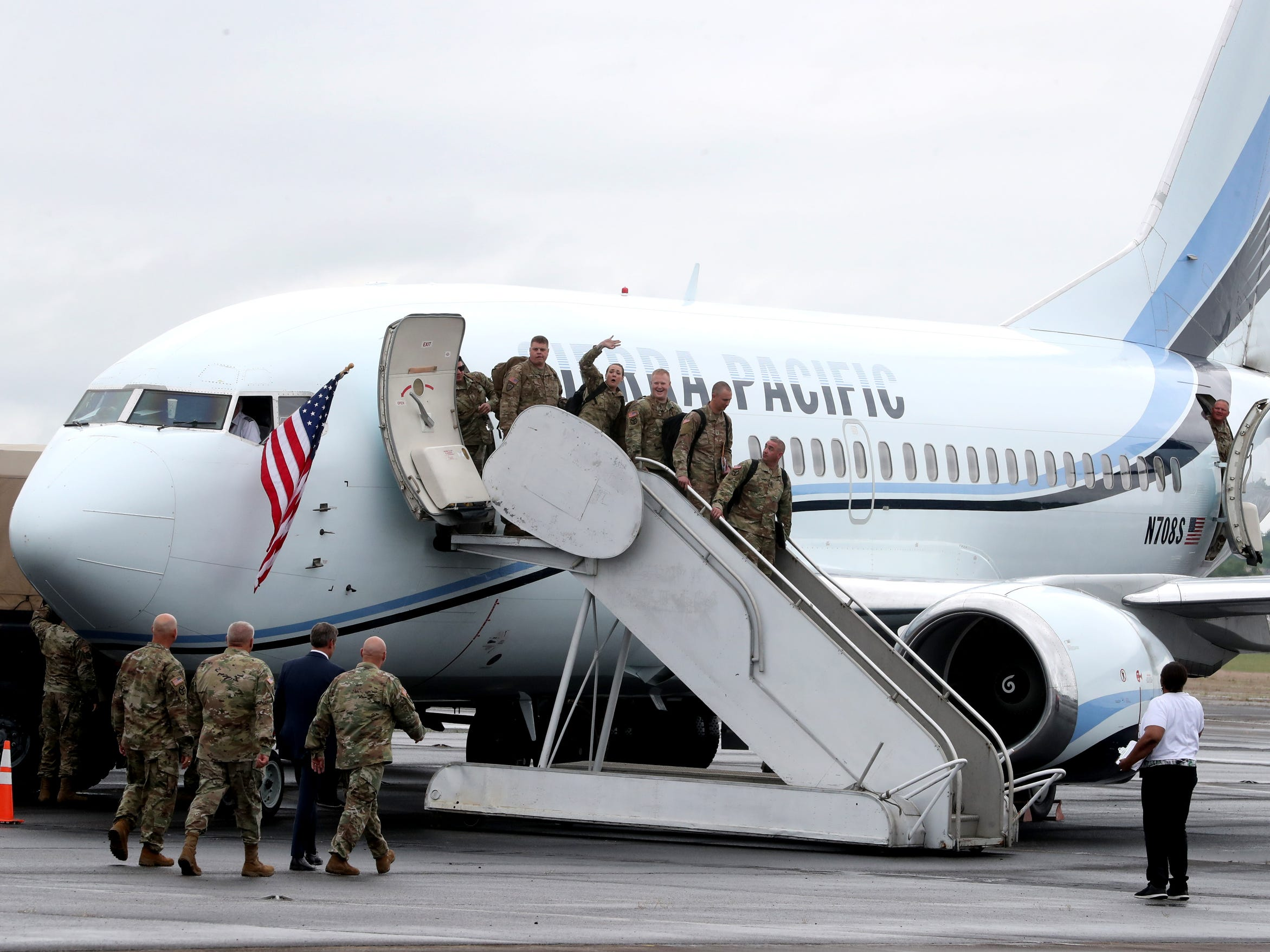 A soldier from the 278th ACR waves to the crowd as the troop gets off the plane, at the Volunteer Training Site in Smyrna, from a 9 month overseas deployment on Thursday, May 9, 2019. Tennessee Governor Bill Lee approaches the plane to welcome the soldiers home.