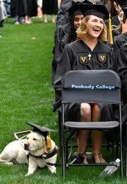Haley Blankenship is accompanied by her guide dog, Tasha, who had her own cap for Vanderbilt University graduation Friday.