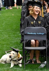 Haley Blankenship is accompanied by her guide dog, Tasha, who had her own cap for Vanderbilt University's graduation Friday, May 10, 2019.