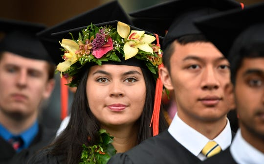 This graduate adorned her cap and gown with fresh flowers to participate in Vanderbilt University graduation Friday.