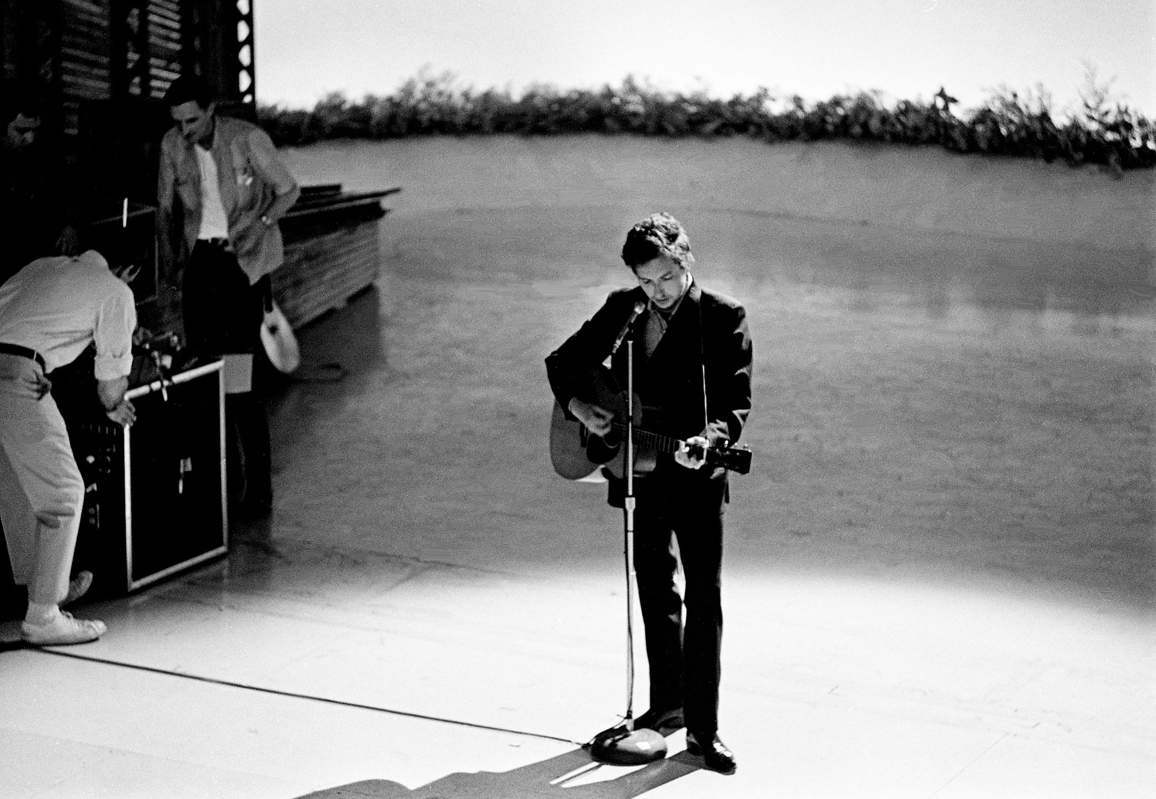 "Guest star Bob Dylan, center, rehearses his song ""I Threw It All Away"" for the first episode of ""The Johnny Cash Show"" at the Ryman Auditorium on May 1, 1969, for ABC-TV."