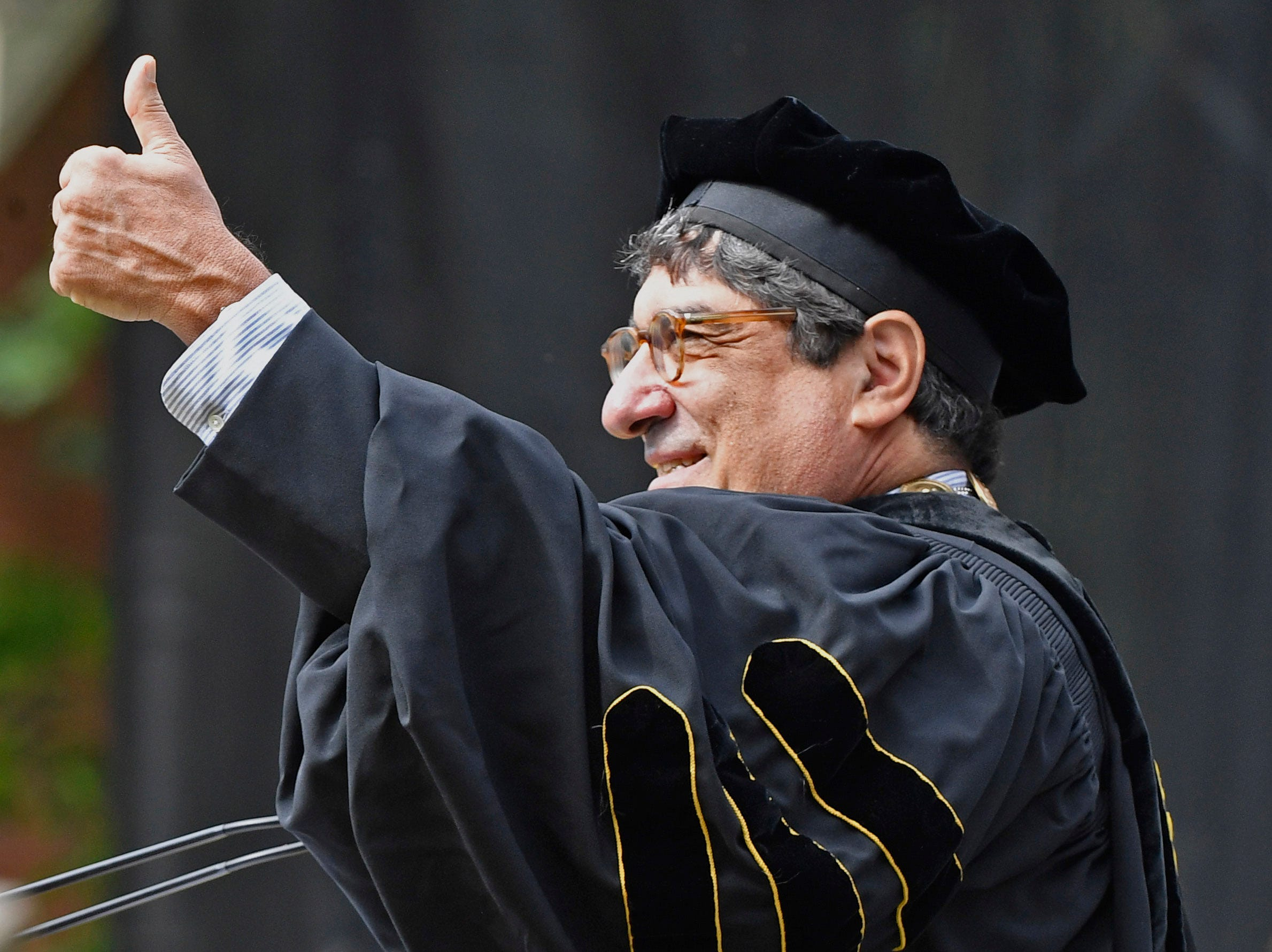 Vanderbilt University Chancellor Nicholas Zeppos gives a thumbs up to the crowd before delivering his commencement speech during Vanderbilt University graduation Friday, May 10, 2019, in Nashville, Tenn.