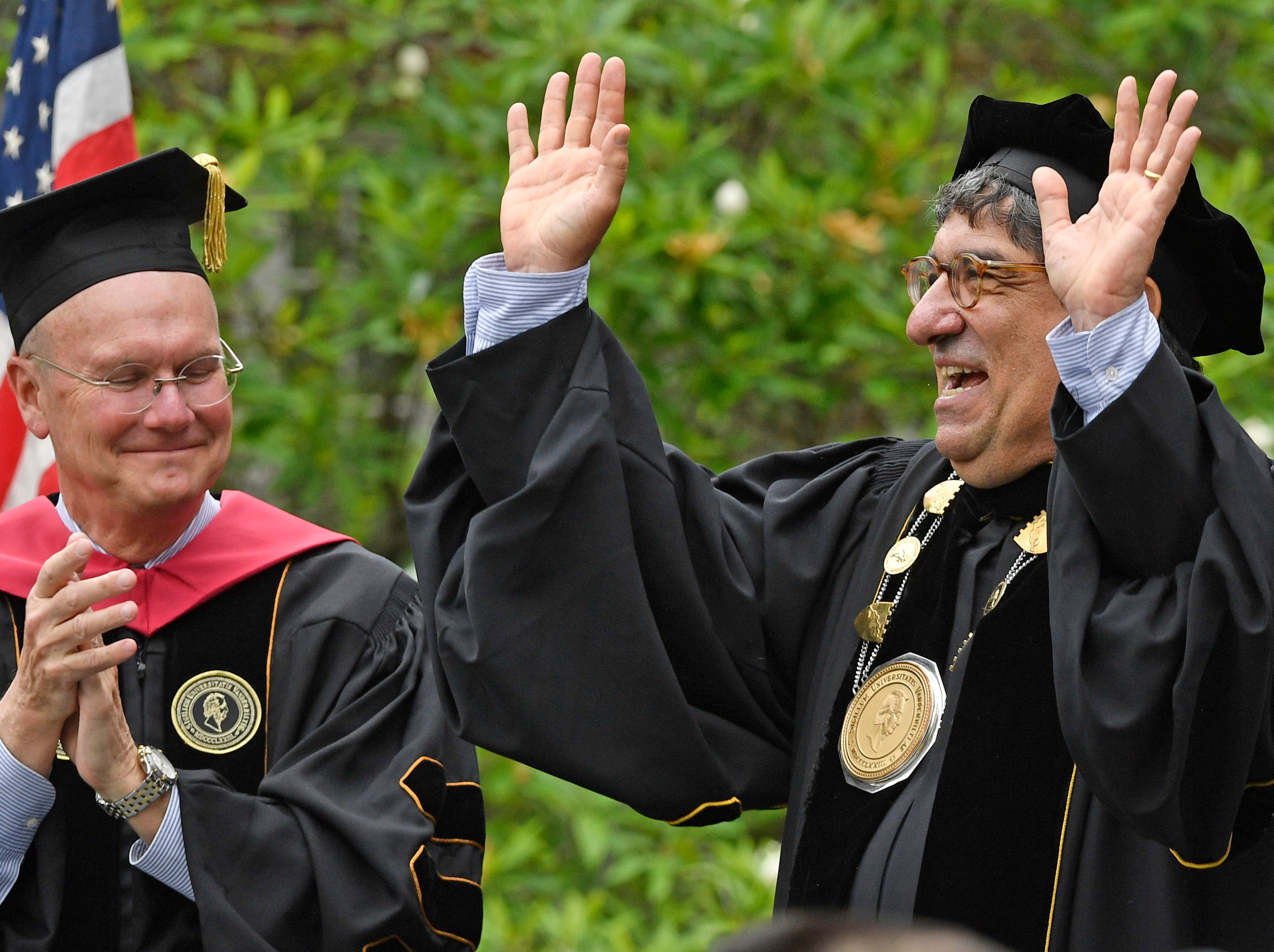 Vanderbilt University Chancellor Nicholas Zeppos waves to the crowd after delivering his commencement speech during Vanderbilt University graduation Friday, May 10, 2019, in Nashville, Tenn.