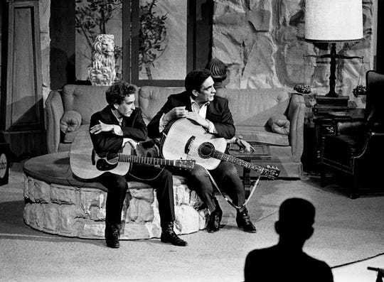"Guest star Bob Dylan, left, and host Johnny Cash wait to sing during the taping of the first episode of ""The Johnny Cash Show"" at the Ryman Auditorium on May 1, 1969. They sang ""The Girl From the North Country,"" a song the two recorded for Dylan's latest album, ""Nashville Skyline,"" recorded in Nashville at the Columbia Records studio."
