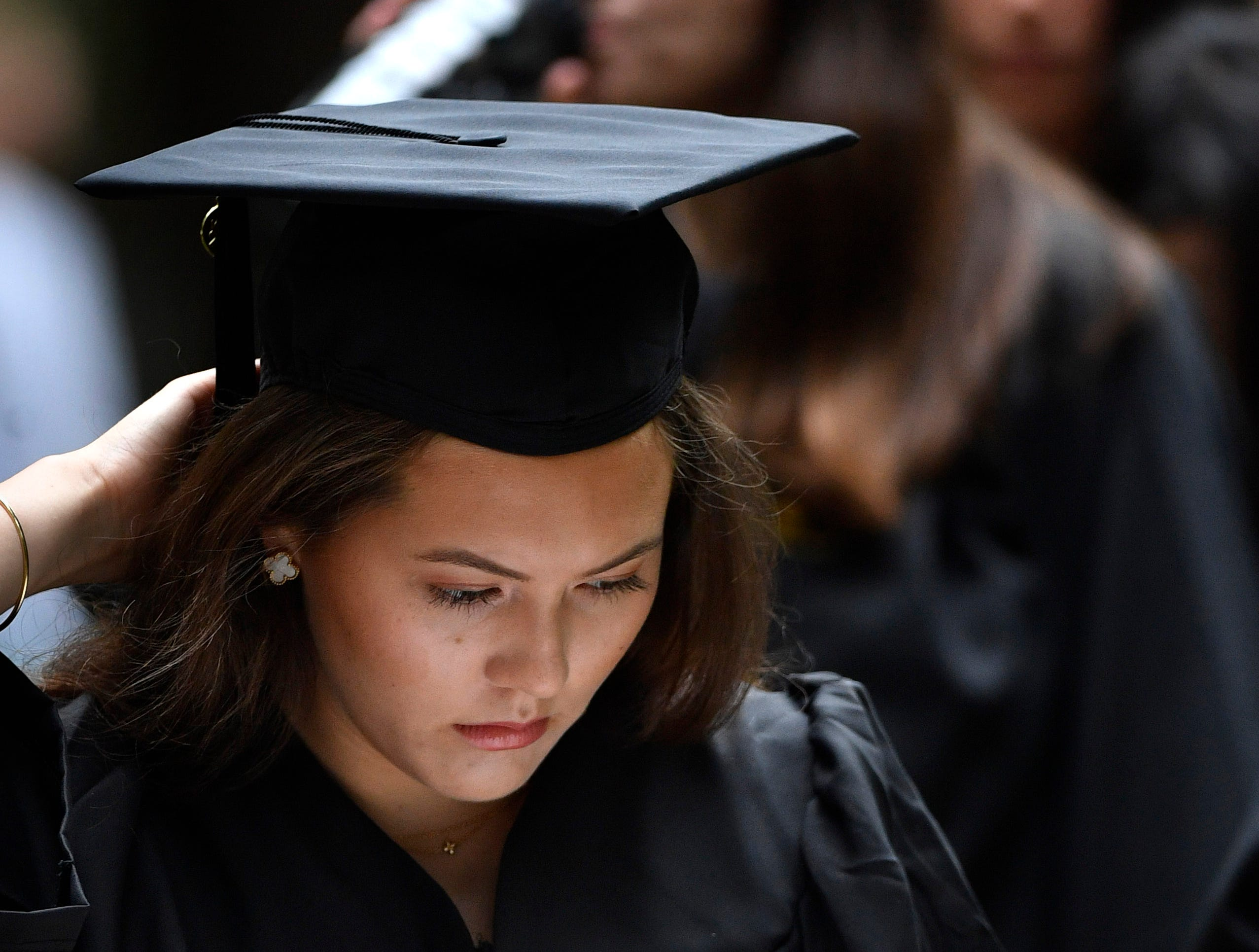 Elizabeth Horner reads the program as she waits for the start of Vanderbilt University graduation Friday, May 10, 2019, in Nashville, Tenn.