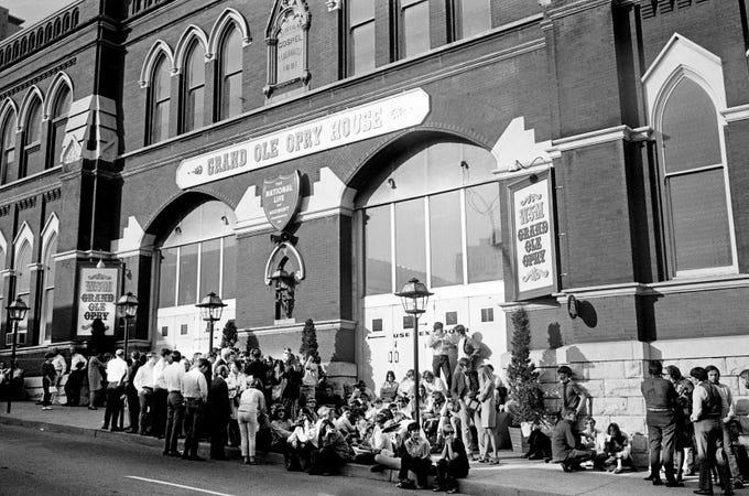 "Bob Dylan fans gather outside the Ryman Auditorium on May 1, 1969, to catch his act during a taping of ""The Johnny Cash Show."" Some strummed guitars and sang during the wait."