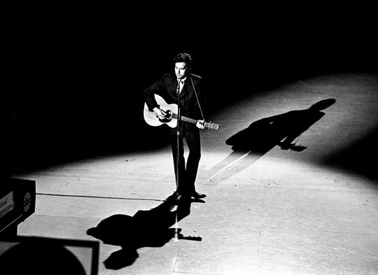 "Guest star Bob Dylan, center, sings ""I Threw It All Away"" during a taping for the first episode of ""The Johnny Cash Show"" at the Ryman Auditorium on May 1, 1969."