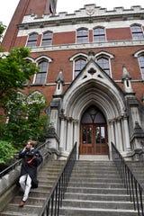 Adam Witte hurries down the steps of Kirkland Hall on graduation day at Vanderbilt University on May 10 in Nashville.