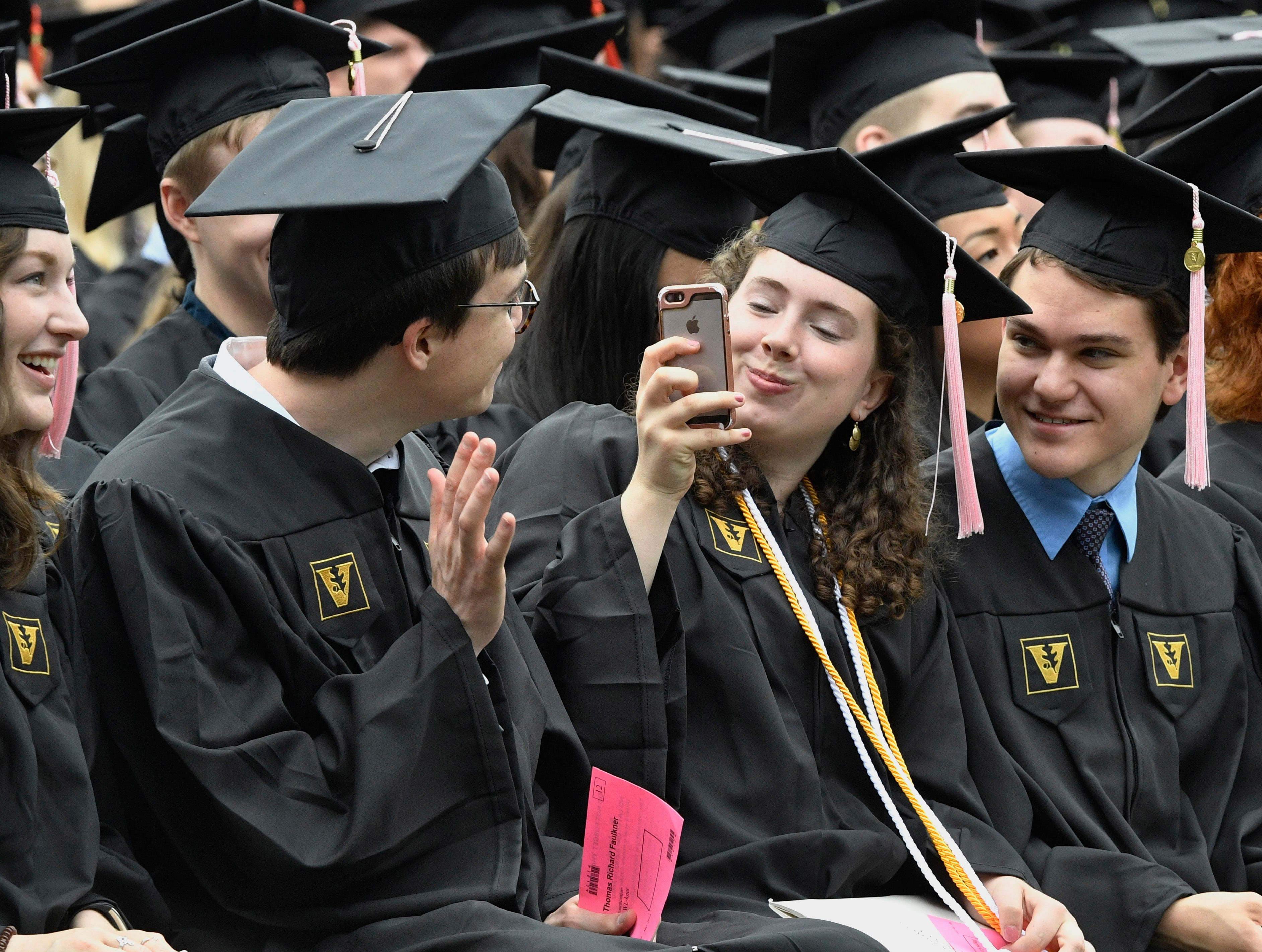 Graduates clown around taking photos before the start of Vanderbilt University graduation Friday, May 10, 2019, in Nashville, Tenn.