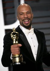 "Rapper Common, holding his Oscar for best original song for ""Glory"" in the film ""Selma,"" arrives for the 2015 Vanity Fair Oscar Party in this February 22, 2015."