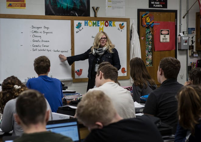 Lisa Yeager talks with her advanced 8th grade science class about a project. Yeager is a science teacher at Granville Middle School.