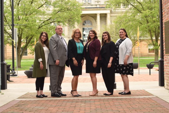 Jennifer McDonald, center left, said it is a joy to manage a staff with numerous millennials. From left, Taylor Lovell, Nate Strum, McDonald, Brittany Misner, Natasha Platt and Atrina Good.