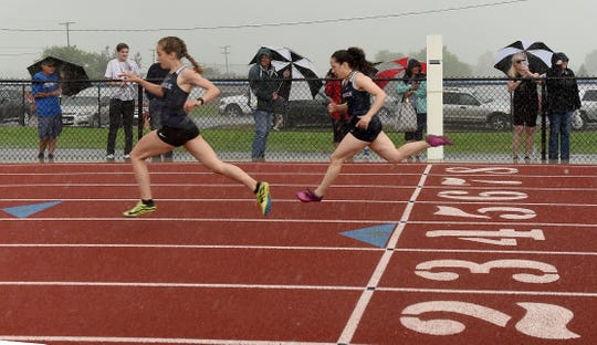 Granville freshman Alania Smith and junior Penny Hunter take the top two spots in the Licking County League-Buckeye Division 100 dash on Thursday, May 9, 2019, at Lakewood High School.