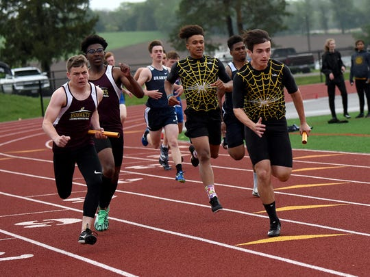Licking Heights competes in the 400 relay May 9 during the Licking County League-Buckeye Division championships.