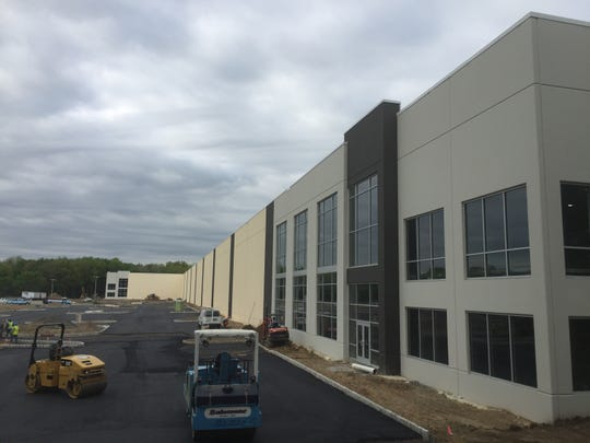 The east side of Kering's new distribution center, where crews were paving a parking lot on May 9.