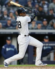 New York Yankees right fielder Cameron Maybin (38) follows through on an RBI double against the Seattle Mariners during the second inning at Yankee Stadium.