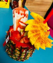 The piñas locas at Piñas Locas Quetzaly is topped with a full ice pop.