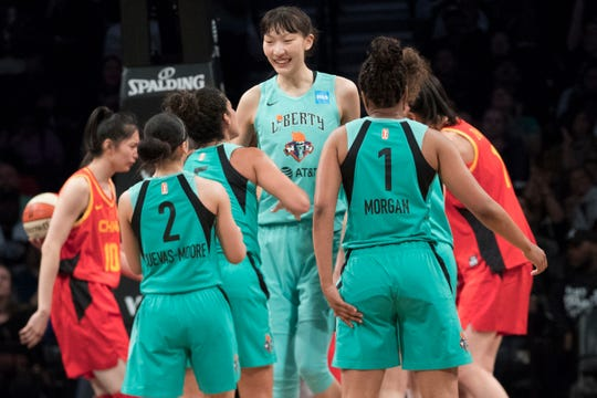 New York Liberty center Han Xu, center, celebrates her goal with her teammates during the second half of the team's WNBA exhibition basketball game against China, Thursday, May 9, 2019, in New York.(AP Photo/Mary Altaffer)