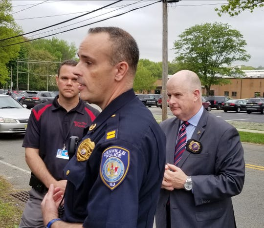 Morris County Sheriff James M. Gannon, right, with Denville Police Capt. Jeff Tucker addressing the media outside the school Friday morning.