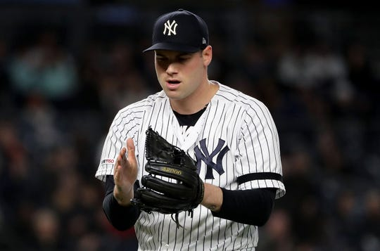 Adam Ottavino of the New York Yankees celebrates the double play to end the sixth inning against the Seattle Mariners at Yankee Stadium on May 9, 2019 in  New York City.