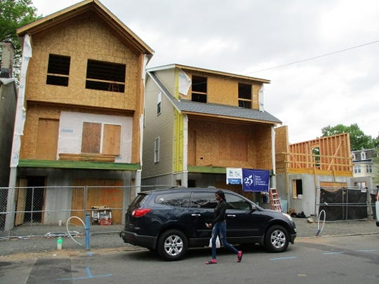 Three homes near completion on Paterson's Hamilton Avenue built by Habitat for Humanity.