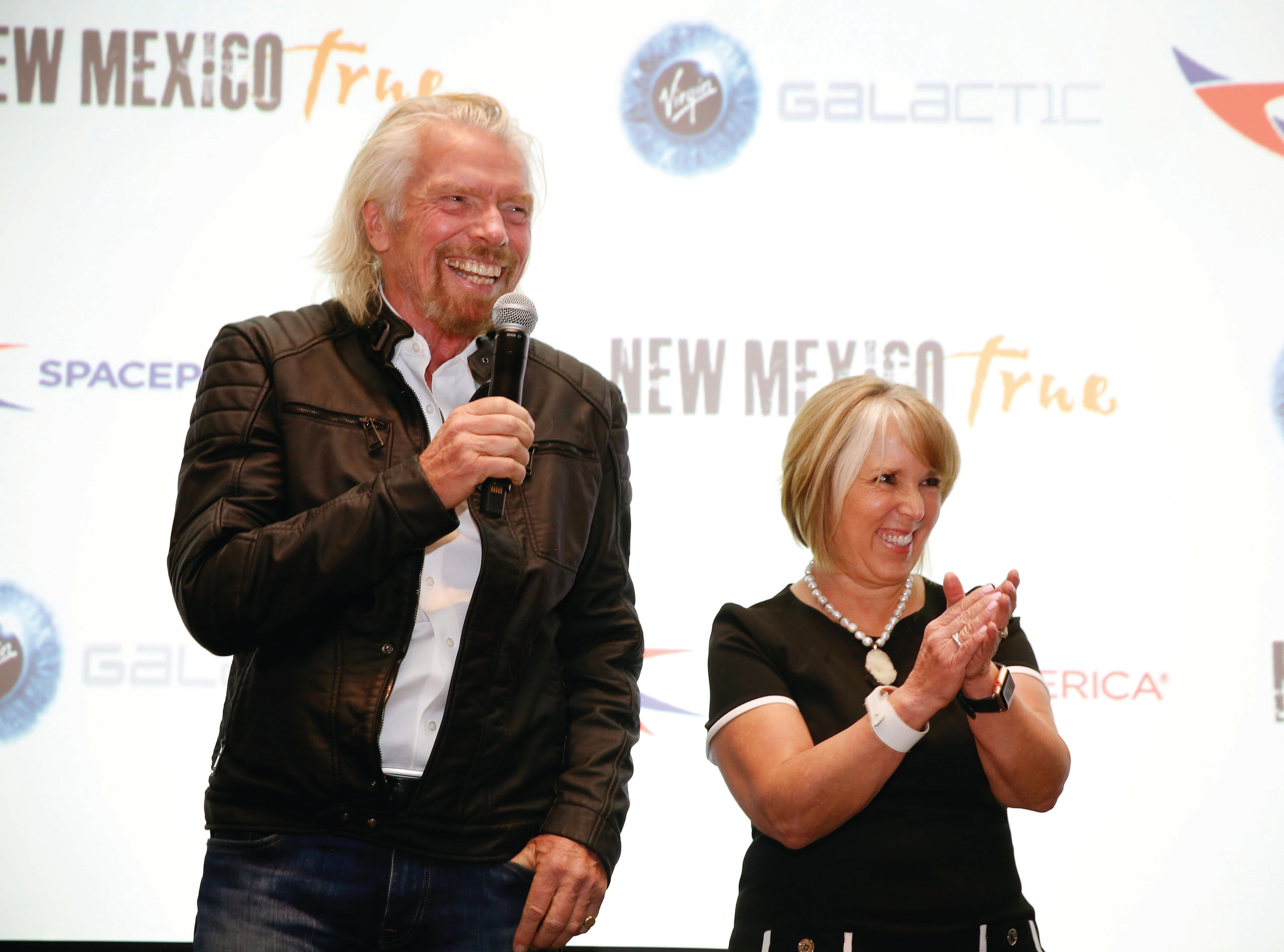Virgin Galactic's Richard Branson and New Mexico Gov. Michelle Lujan Grisham answer questions during the space company's announcement in Santa Fe on Friday, May 10, 2019.