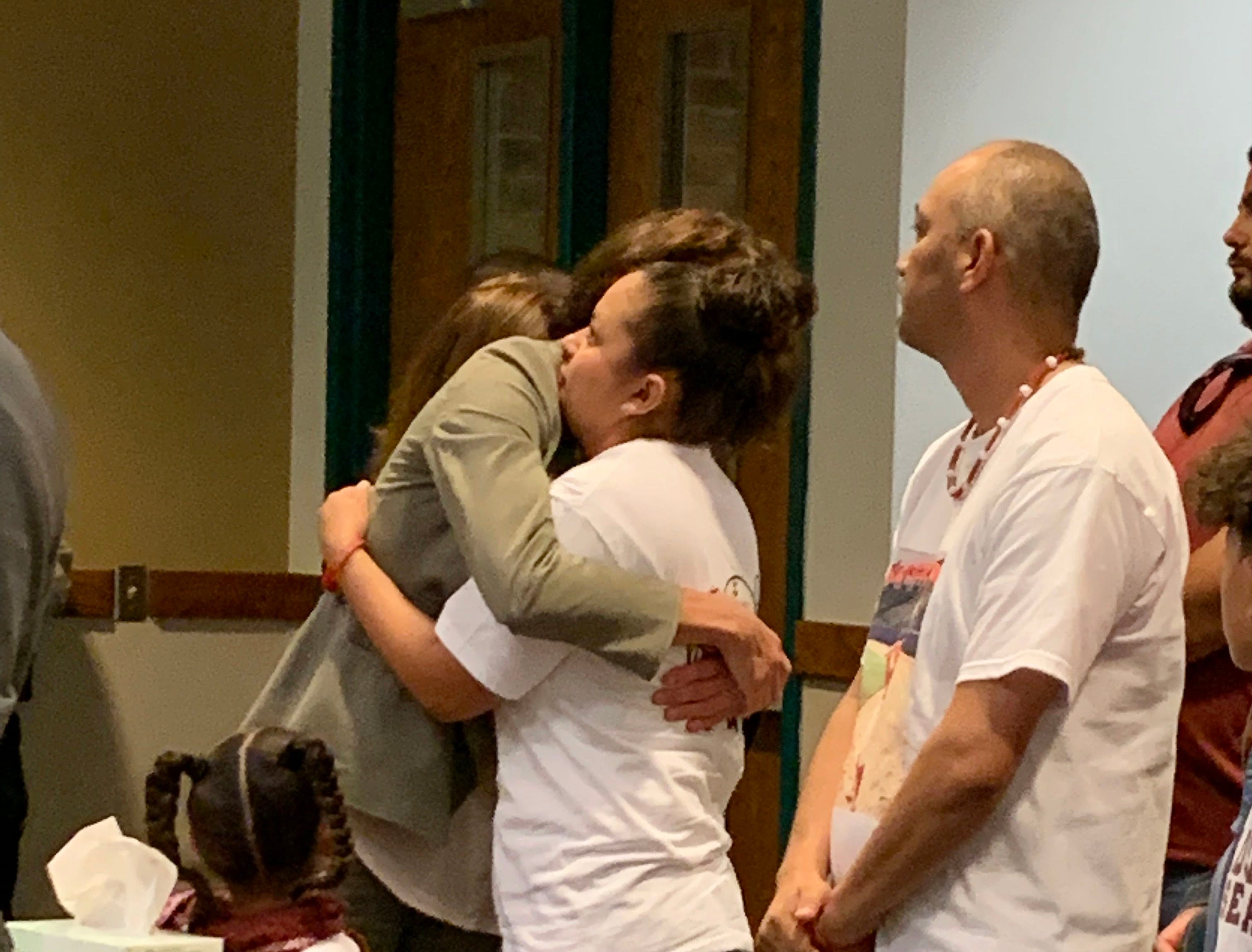 Beto Romero's mother Denise Romero, center, hugs prosecuting attorney Debra Gerard, after an evidentiary hearing Friday May 10, 2019, in 3rd Judicial District Court. Beto Romero Sr. looks on.