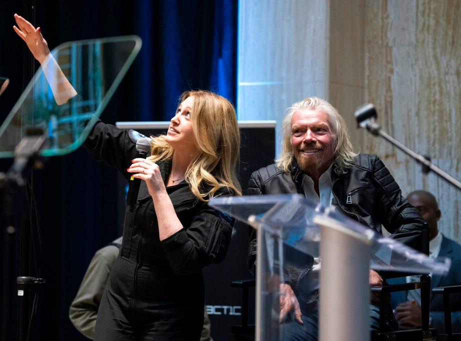 Beth Moses, chief astronaut instructor, describes her flight into space while on stage with Virgin Galactic founder Sir Richard Branson, right, during an event announcing the company's move to New Mexico Friday, May 10, 2019, at the state capital in Santa Fe, N.M. The company says is it nearing the first commercial flights from the Spaceport America.