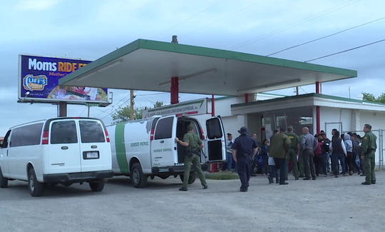 In this still from a city of Las Cruces video clip, a group of migrants and Border Patrol agents are seen standing outside the El Paso-Los Angeles Limousine Express Inc., 555 S. Valley Drive, in Las Cruces after federal authorities dropped them off there on Friday, May 10, 2019.
