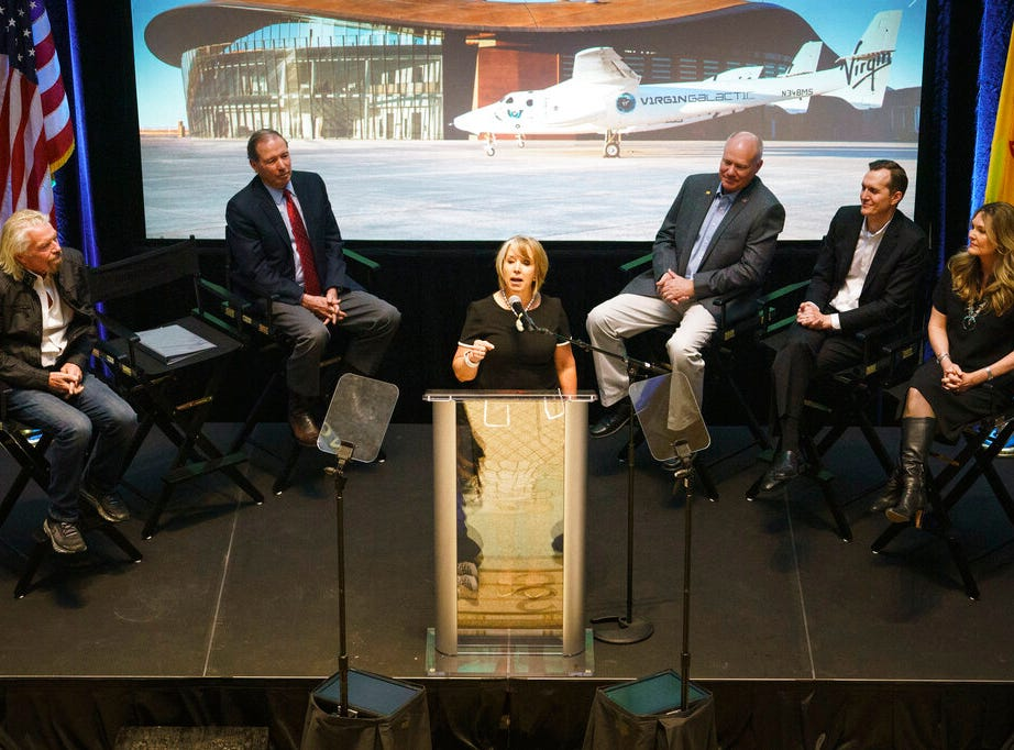 New Mexico Gov. Michelle Lujan Grisham speaks during an event announcing Virgin Galactic's move to New Mexico Friday, May 10, 2019, at the state capital in Santa Fe, N.M. The company says it is nearing the first commercial flights from the Spaceport America.