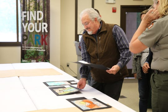 Dave Morgan, director of the Carlsbad Museum and Art Center, during the final round of judging in the Guadalupe Mountains National Park Youth Poster Contest May 10, 2019.