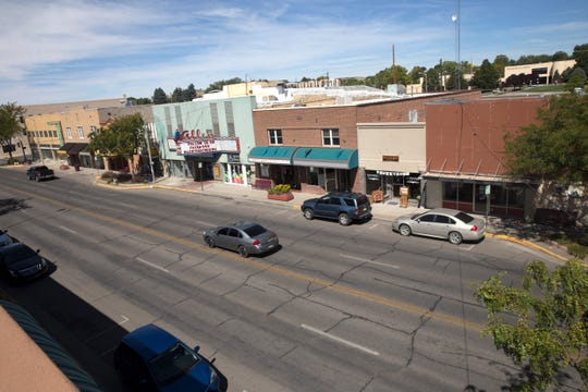 Vehicles drive along West Main Street, Tuesday, Sept. 19, 2017 in Farmington in this file photo.