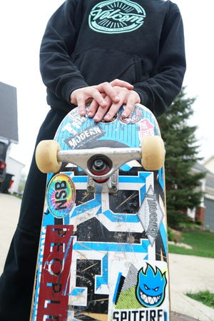 Duke Stempien, 11, with his much sticker-covered skateboard. A Patronicity campaign has been launched to raise $50,000 for a skatepark in Milford. If the goal is reached by April 12, the village will receive a matching grant, making the park a reality.