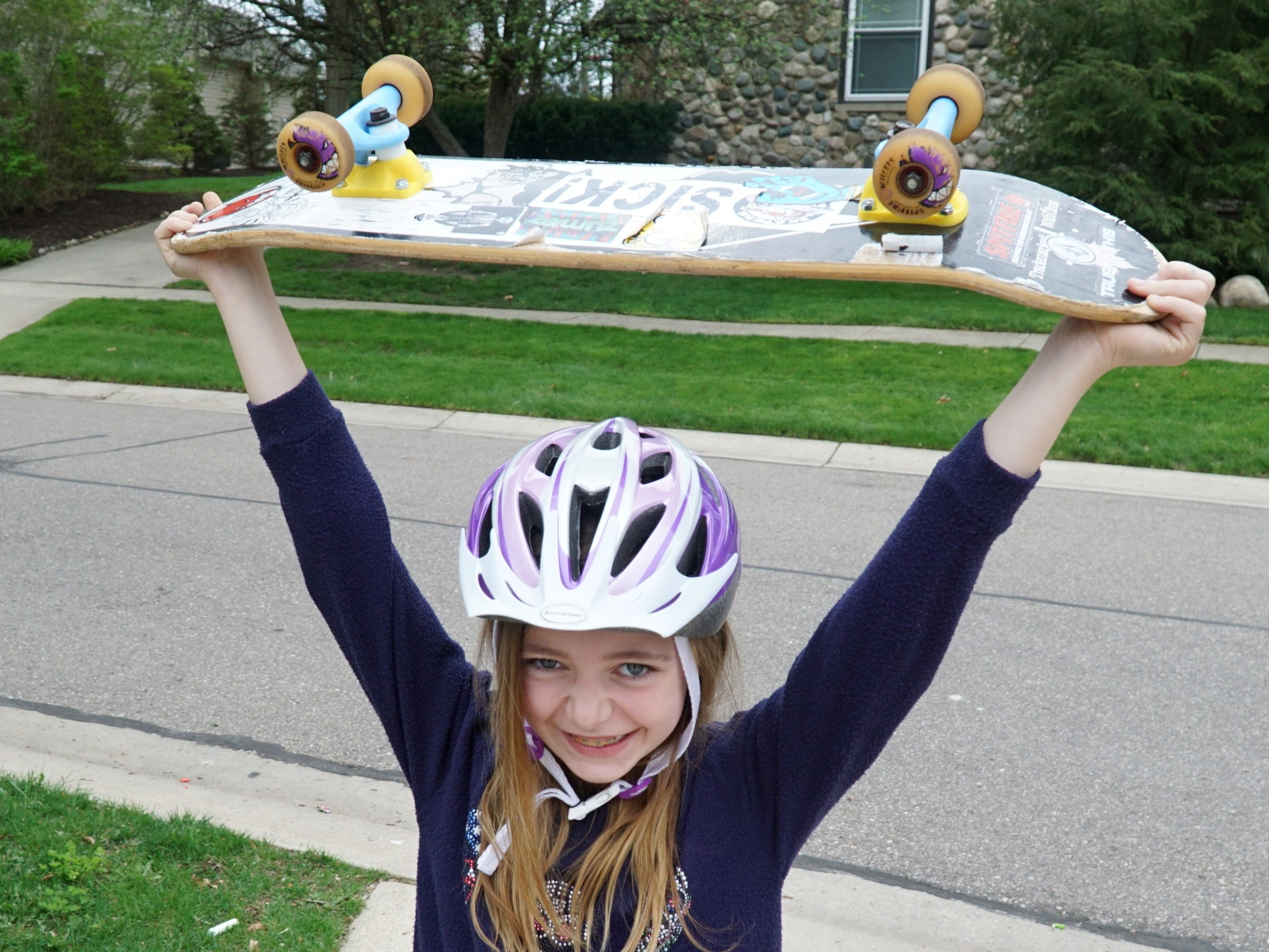 Lovey Stempien, 9, is hoping to raise her skateboard in triumph - should the Village of Milford okay a skate park near its senior center.