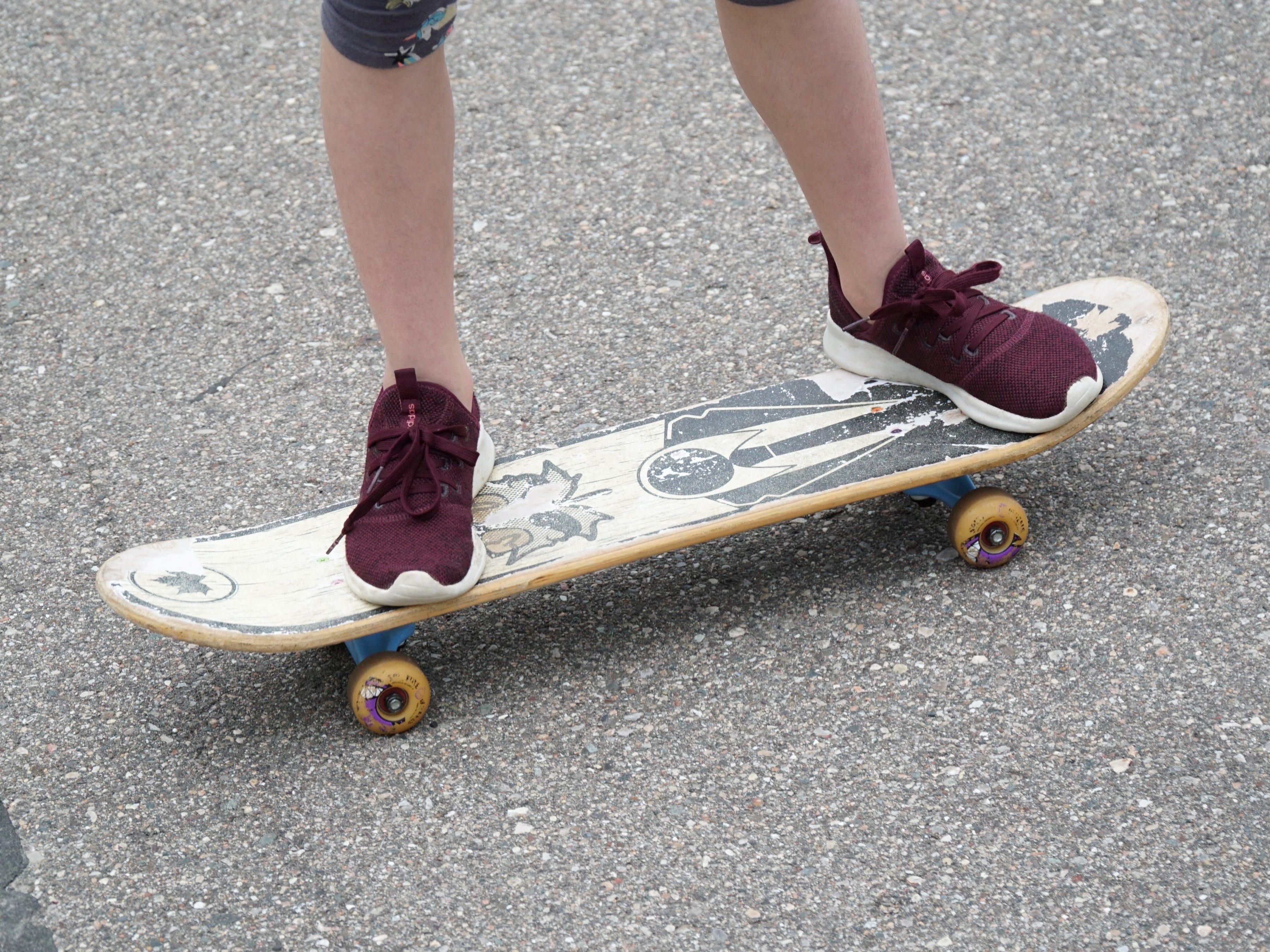 Lovey Stempien, 9, on her skateboard.