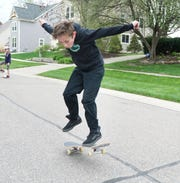 Duke Stempien, 11, gets a little bit of air-time on his block in the Village of Milford. The youngster's mom Kristi is hoping the village will build a skateboard park near its senior center.