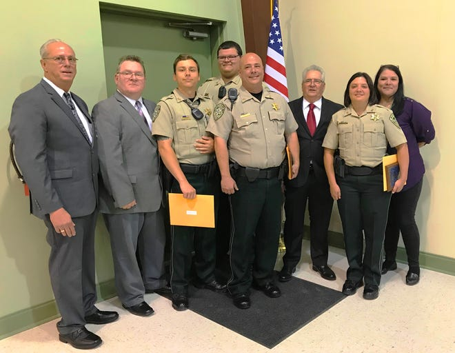 Three St. Landry Parish Sheriff's deputies graduated Wednesday from the 53rd session of St. Martin Sheriff's Basic Training Academy. Pictured from left front row are Deputy Chief David Meche, patrol supervisor; Deputy Chief Eddie Thibodeaux, director of training and professional development; deputy Jordan Lanclos; deputy Chad Castille; and deputy Brandy Marks. Back row from left are deputy Devin Johnson; Deputy Chief Bruce Stansbury, Criminal Investigations Division; and Capt.  Melana Callier.