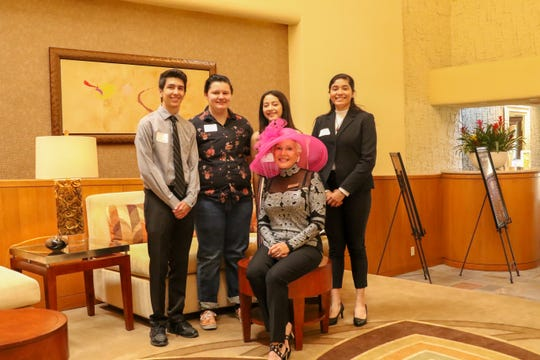 Seated: President Lillian Kuzmanic. Standing, from left:  Scholarship winners Mathew Lawrence, Caitlin Alex Melton, Valeria Placencia and Jenna Tijerina
