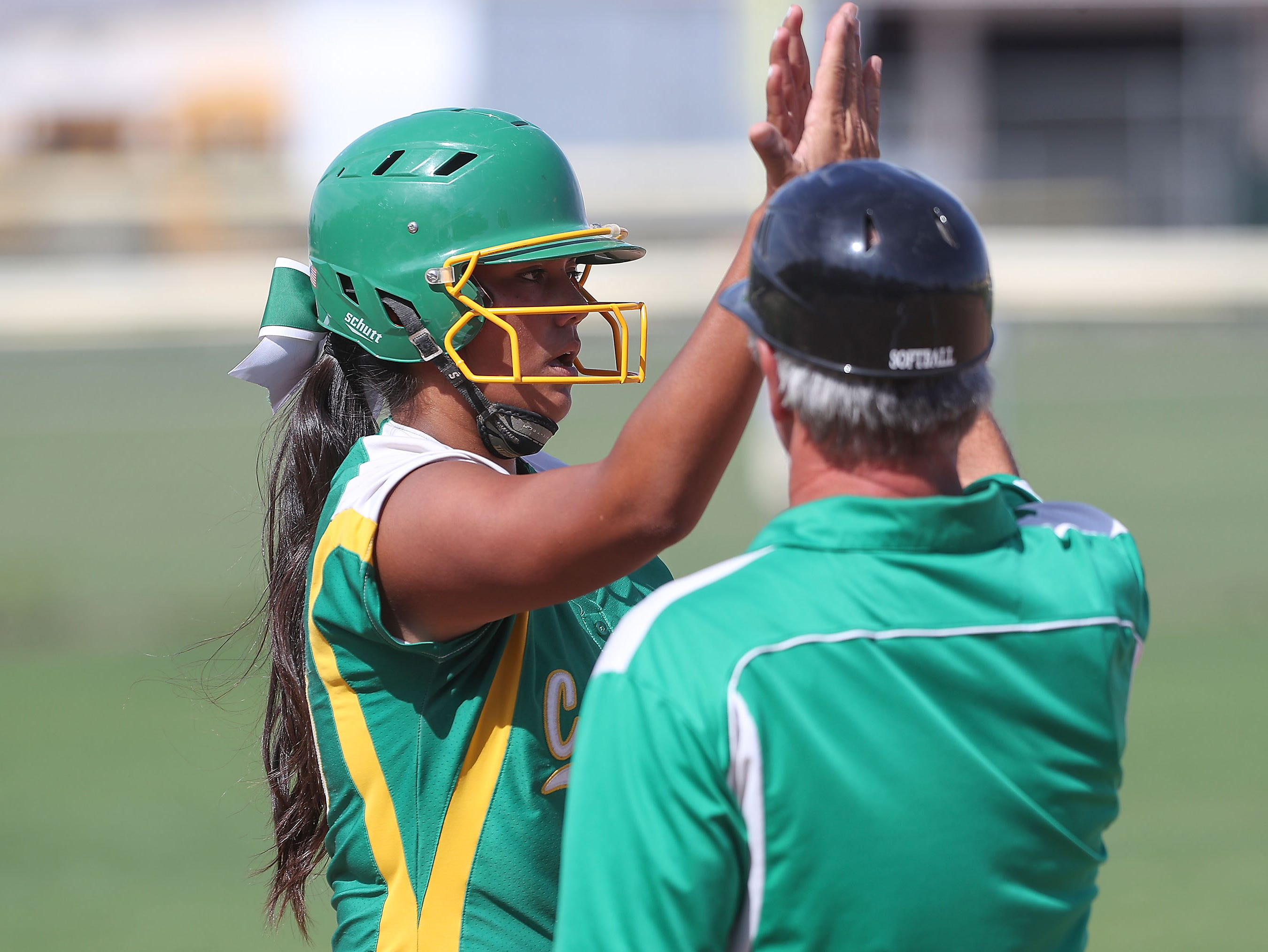 Cheyenne Sandoval of Coachella Valley gets a high five from a coach during their game against Anaheim May 9, 2019.