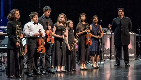Members of the Buddy Rogers Youth Symphony and Beginning Strings Conservatory receiving grants with Todd Montemayor, BRYS, Director