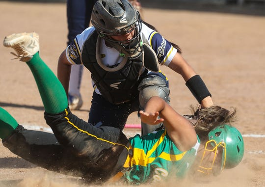Kamryn Flores of Coachella Valley is tagged out at the plate against Anaheim during the Arabs loss, May 9, 2019.