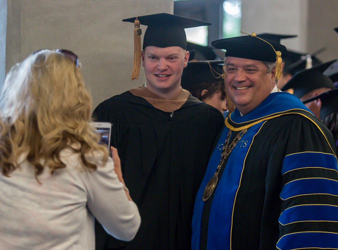 Pensacola Christian College President Dr. Troy Shoemaker, right, poses for a photo on Friday, May 10, 2019, before the school's 44th commencement ceremony.