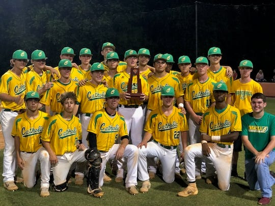 The Catholic Crusaders celebrate their fourth-consecutive district championship.