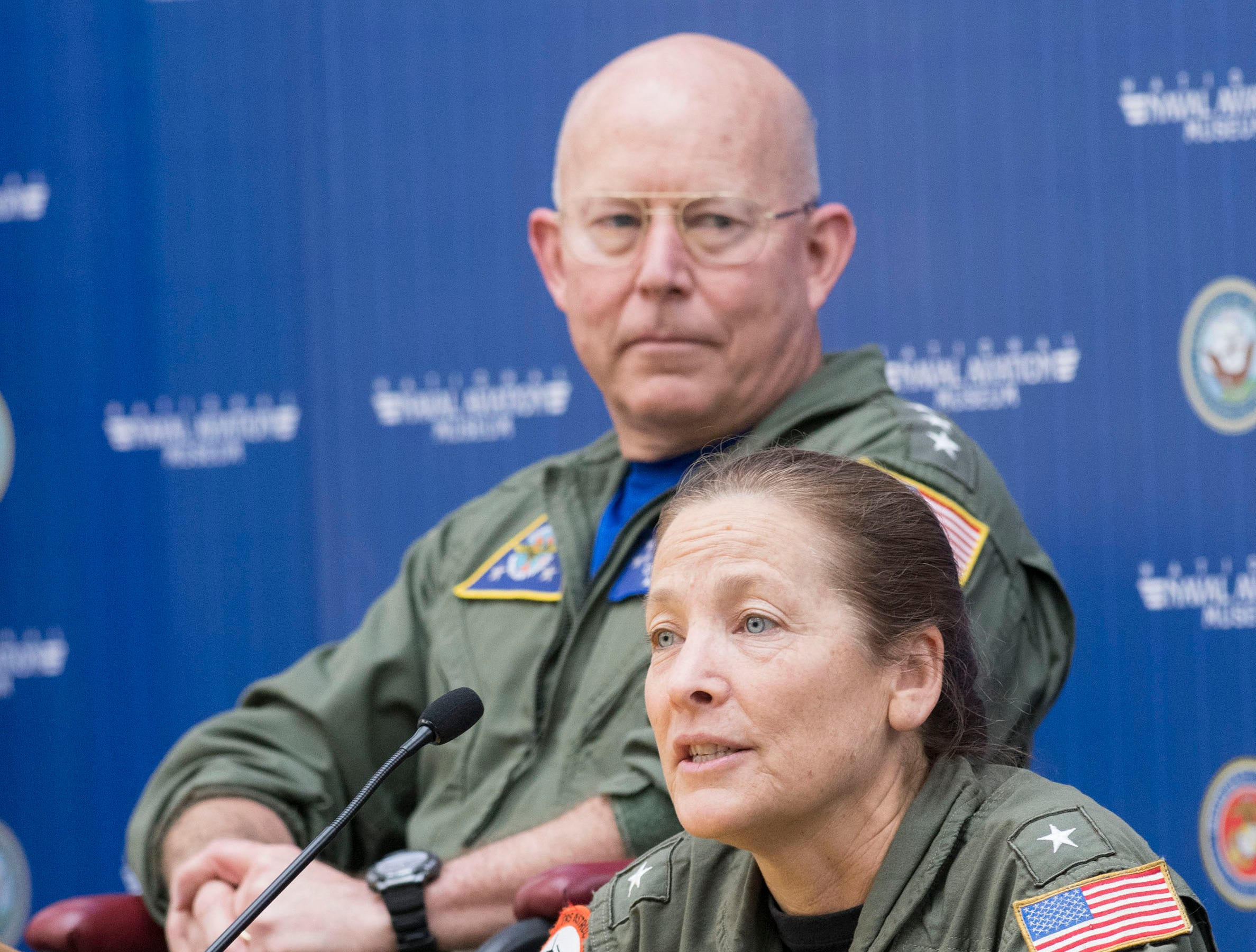"""Rear Adm. Shoshana Chatfield offers her insights to young aviators during a discussion panel entitled """"Naval Aviation Today and Tomorrow"""" during the 2019 Naval Aviation Symposium at the National Naval Aviation Museum on Friday, May 10, 2019, while Vice Adm. DeWolfe Miller looks on."""