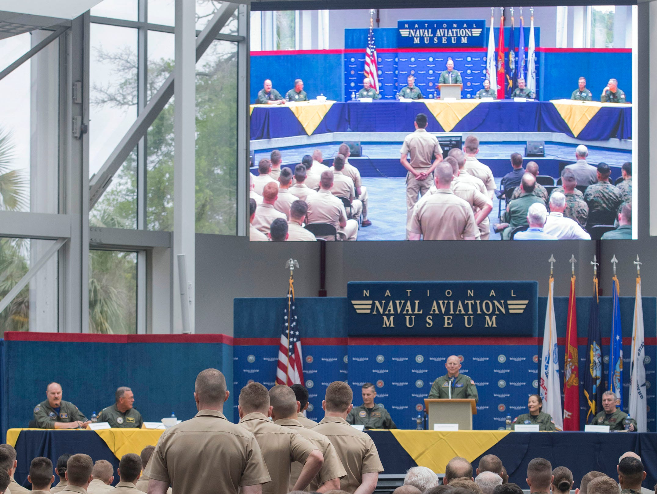 Navy, Marine Corps, and Coast Guard flight students and pilots gather at the National Naval Aviation Museum to learn more about the present and future of  Naval Aviation from a distinguished panel of flag officers on Friday, May 9, 2019.