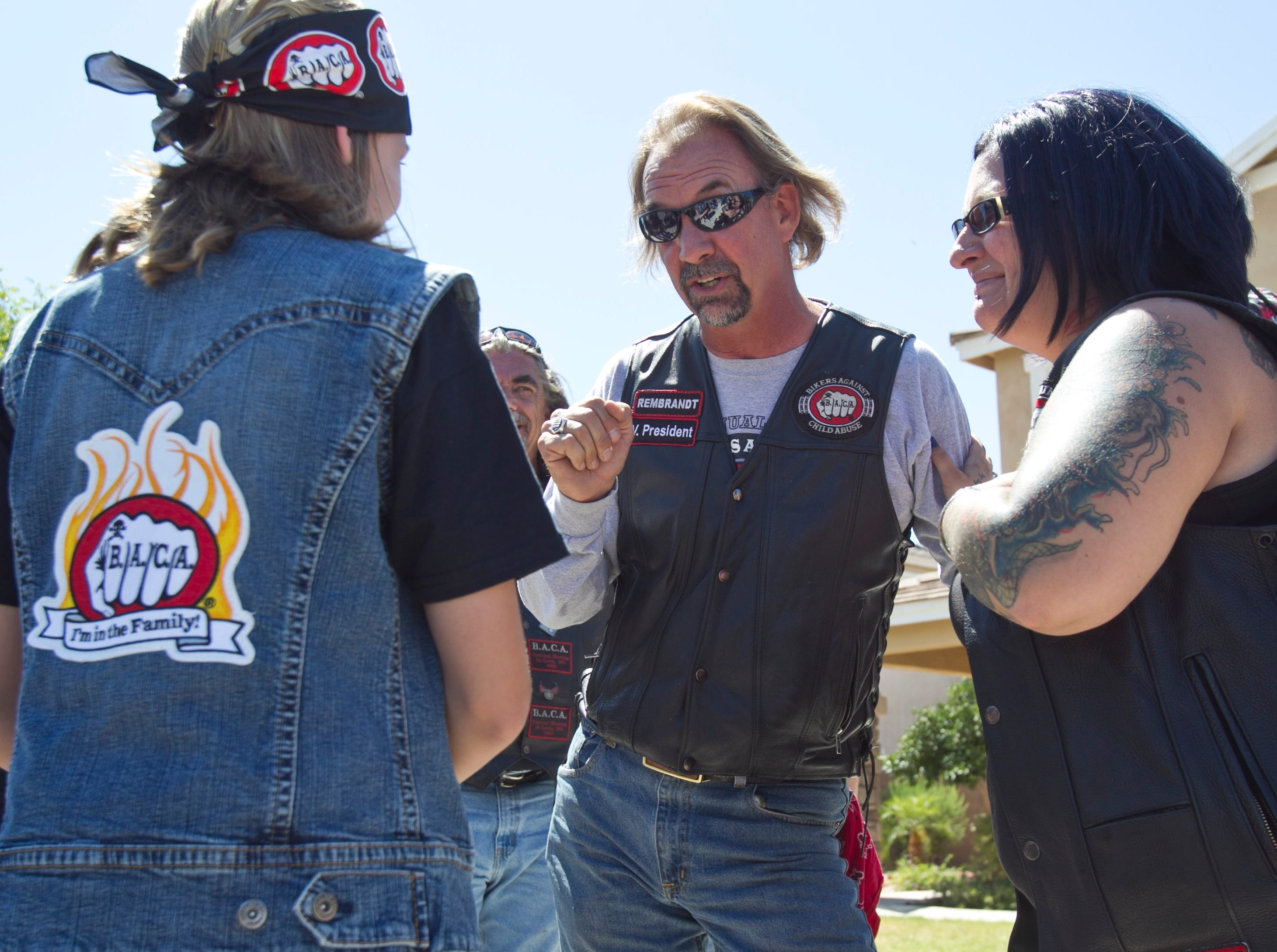 Rembrandt (center) and other members of Bikers Against Child Abuse meet with a child who has been the victim of abuse.